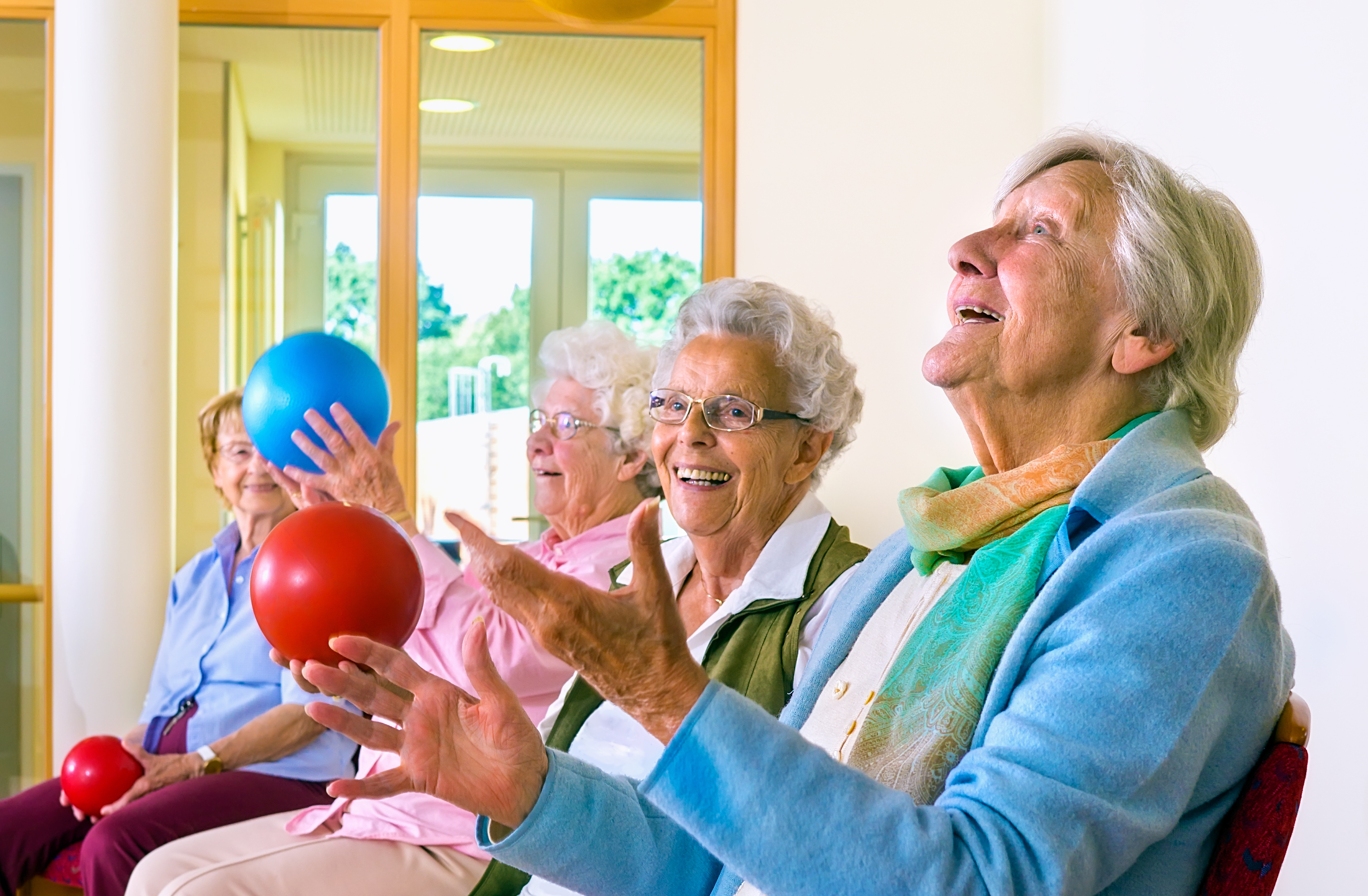 Group of elderly ladies in a seniors gym ageright